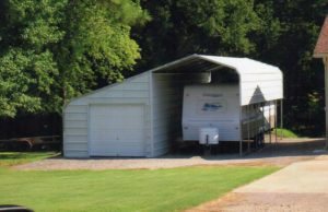24 x 30 slant roof RV cover and enclosed side stall with 9 x 7 garage door.